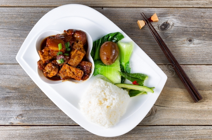 Chinese fried tofu dish in bowl setting ready to eat