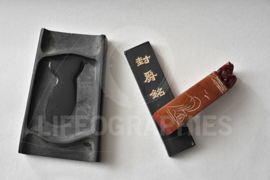 Chinese paintbrushes ink stone and stamp