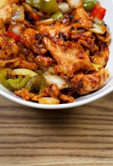 Chinese Spicy Chicken Dish in white bowl