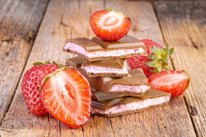 Chocolate with strawberry cream on wooden