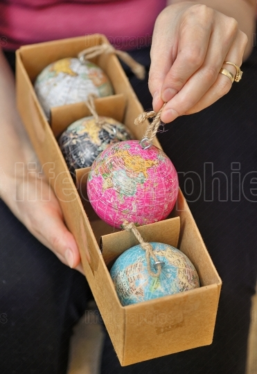 Christmas balls shaped as globe in box