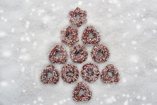 Christmas cookies tree made by cinnamon with snowy background