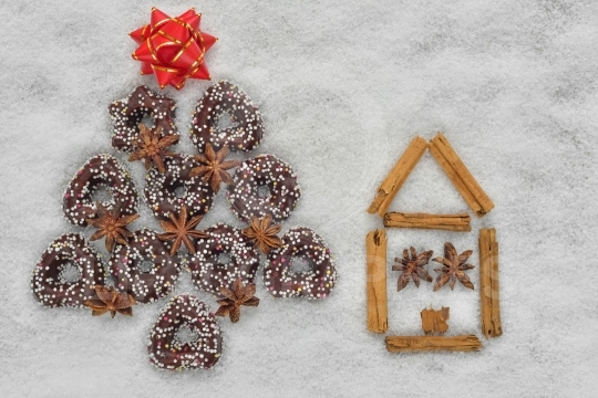 Christmas cookies tree near a house made by cinnamon