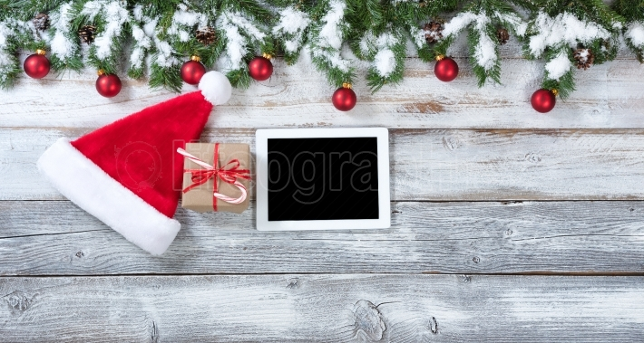 Christmas gift and technology background on rustic white wood