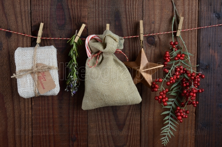 Christmas Gifts and Decorations Hanging From Twine