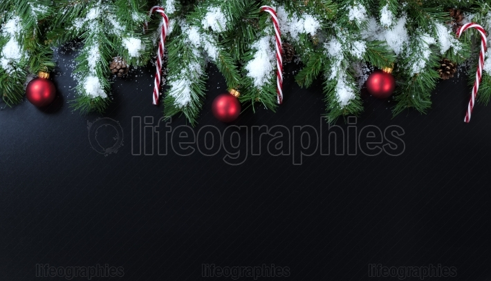 Christmas snowy evergreen with ornaments