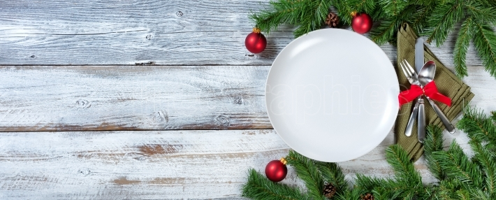 Christmas Table place setting on rustic white wood