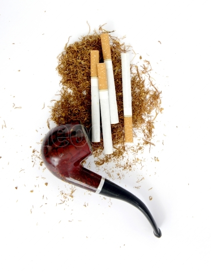 Cigarettes ,pipe and tobacco , close up