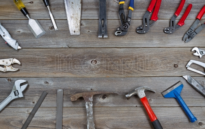 Circle of Tools on Rustic Wooden Boards