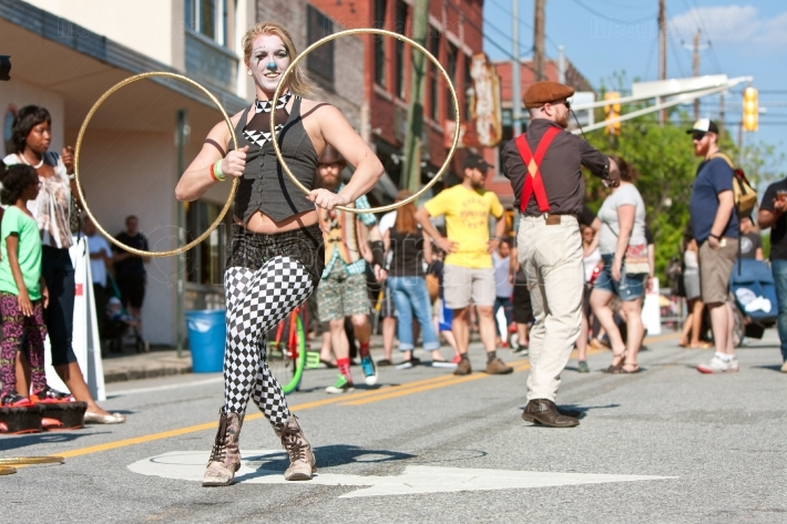 Circus performers entertain people at atlanta street festival