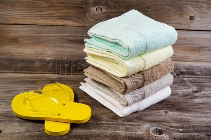Clean Sandals and Towels on Weathered Wood