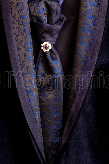 Close up details of black costume with tie