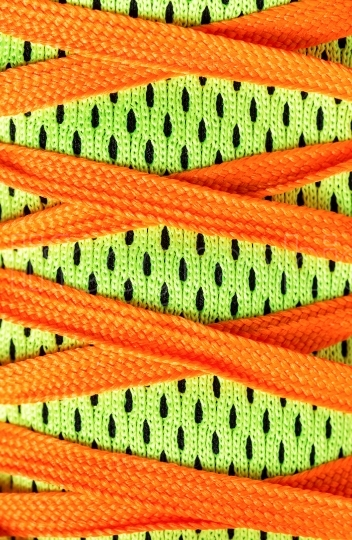 Close up laces shoes with complementary colors