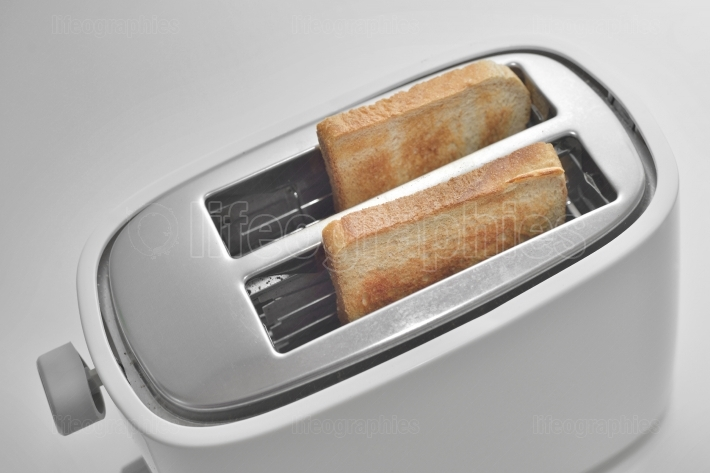 Close up of a toaster with slices of bread