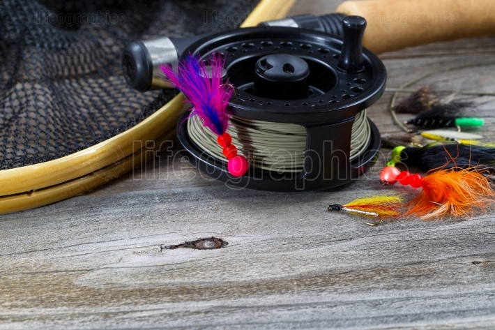Close up of Fly Reel with fly jig hanging from spool