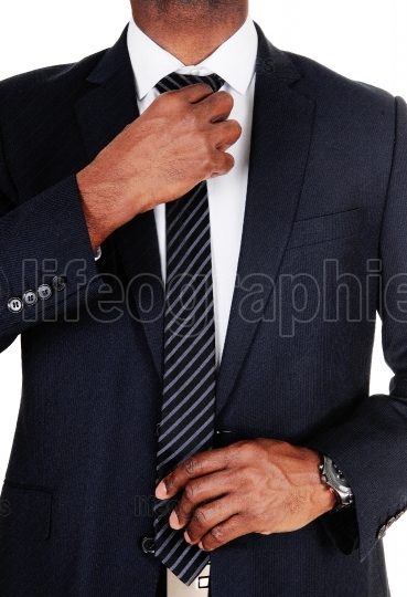Close up of middle section of business man in a suit
