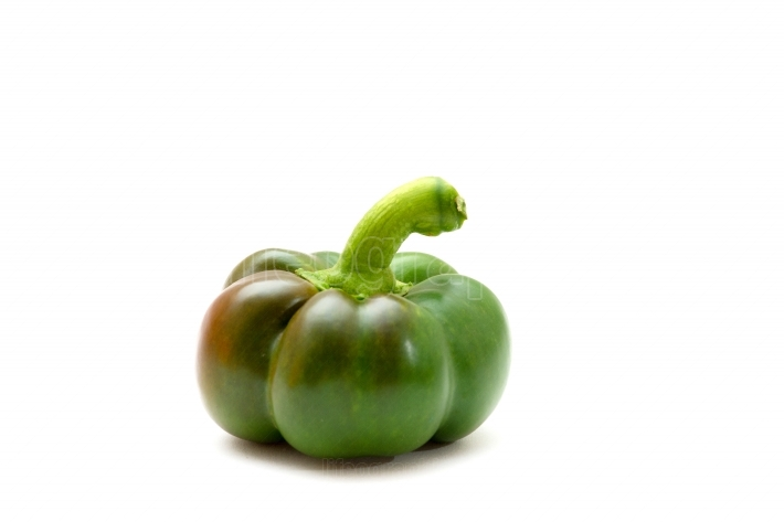 Closeup of a green pepper isolated on white background