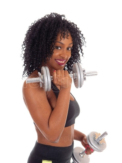Closeup of african american woman with dumbbell's.