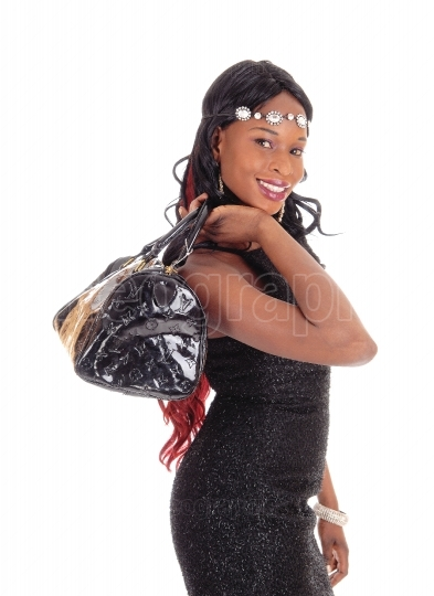 Closeup of African American woman with purse.