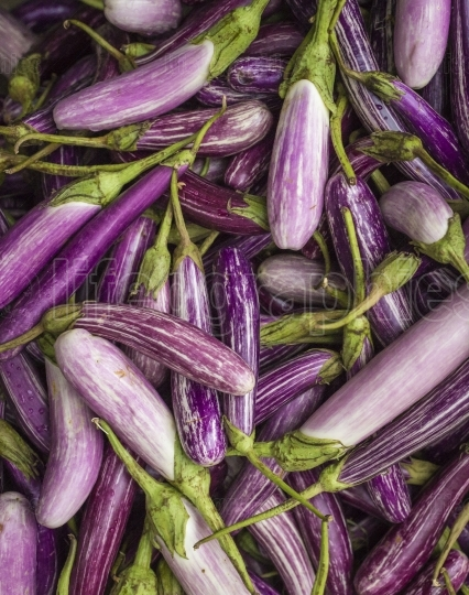 Closeup of eggplants on vegetable market in kandy, sri lanka.