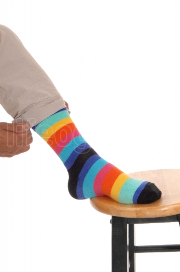 Closeup of foot with colorful socks.