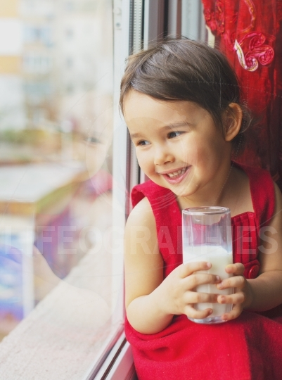 Closeup of little girl drinking milk