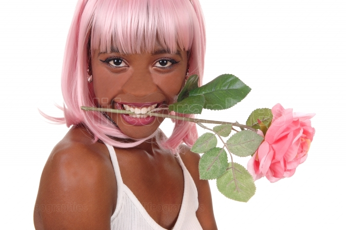 Closeup of woman with pink rose in mouth