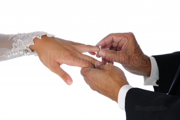 Closeup Placing Ring On Brides Hand