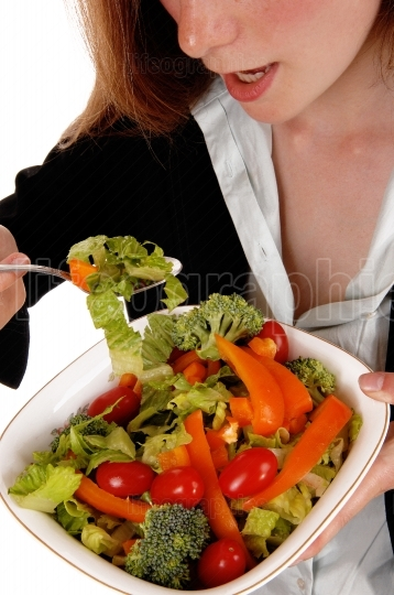Closeup woman eating salad