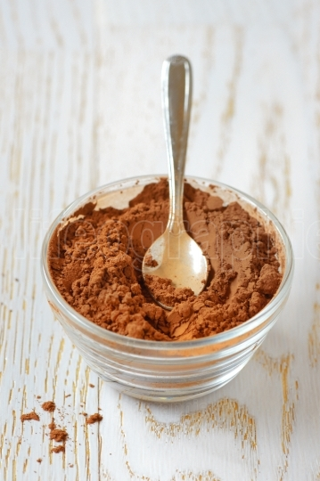 Cocoa powder with a spoon