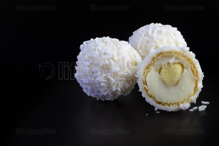 Coconut balls on black background