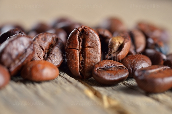 Coffee beans closeup on wooden table