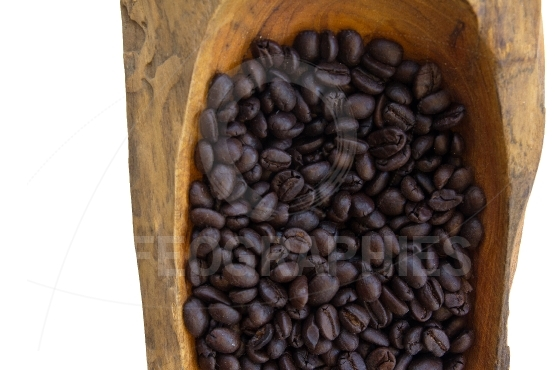 Coffee beans in a wooden bowls, close up,