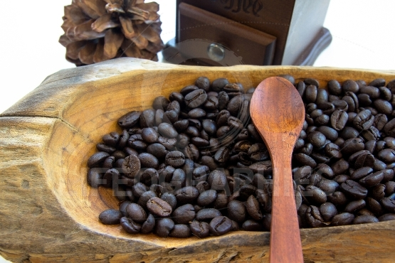 Coffee beans in a wooden bowls, close up, horizontal