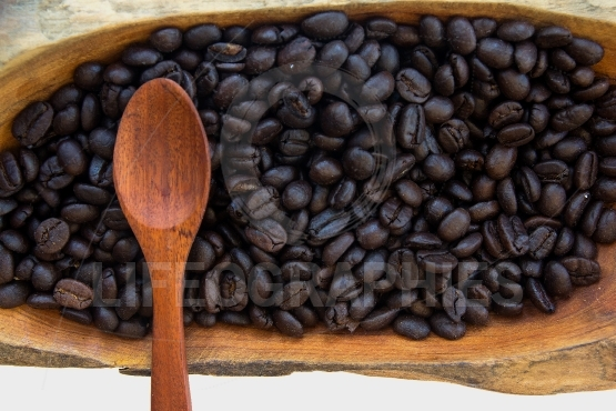 Coffee beans in a wooden bowls vintage