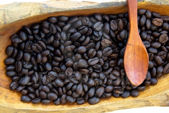 Coffee beans in a wooden bowls vintage and spoon wood
