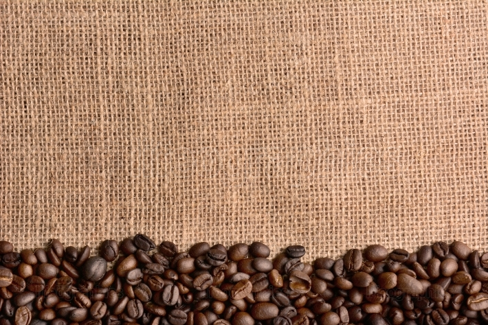 Coffee Beans on Burlap Surface