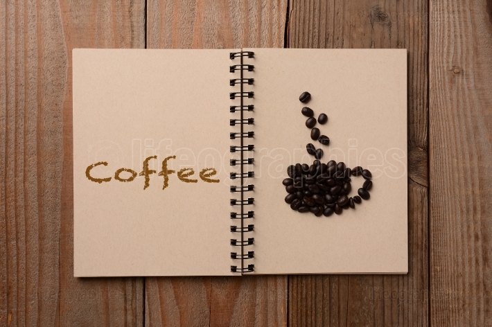 Coffee Beans on Open Notebook