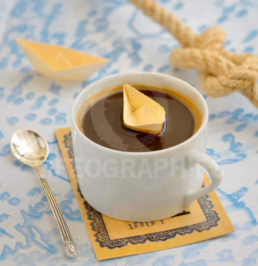 Coffee cup and paper boat