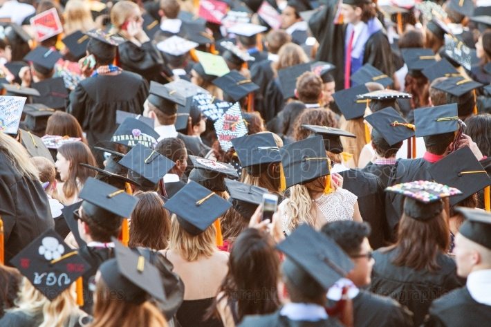College Graduates Wearing Mortar Boards Gather For Graduation Ac