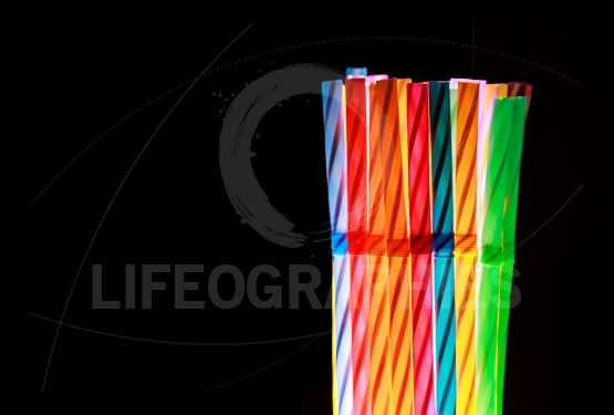 Colorful drinking straws on black background
