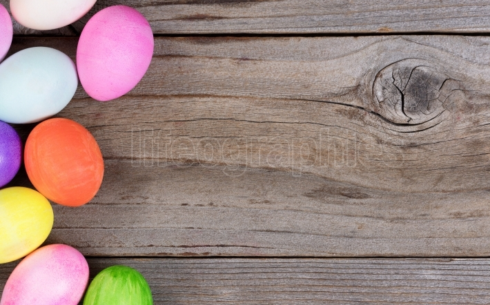 Colorful eggs for Easter holiday forming left hand border on rus