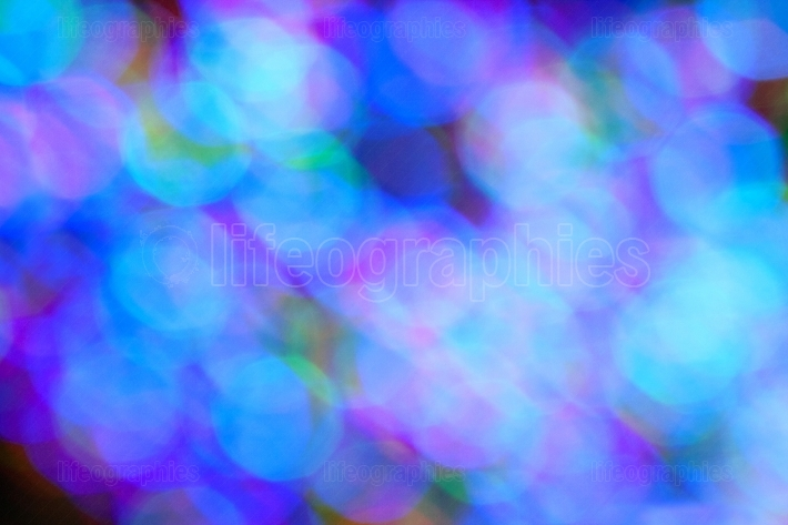 Colorful holiday lights create blue bokeh