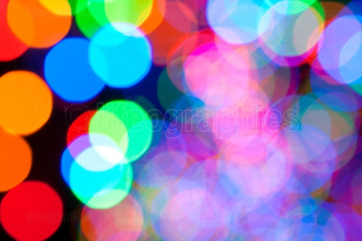 Colorful holiday lights create bokeh background