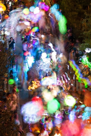 Colorful Lanterns Motion Blur As People Walk In Night Parade