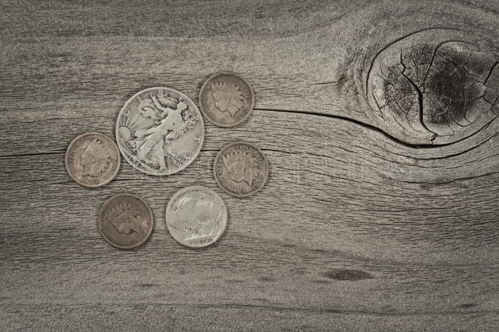 Concept of vintage coins on aged wood