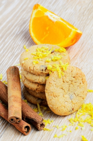Cookies and orange fruit on wood background