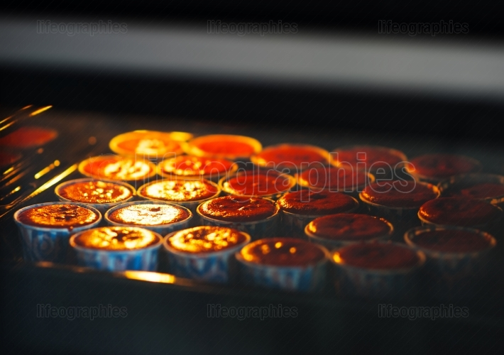 Cooking cupcakes in oven backdrop