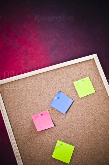 Cork board with colored post notes
