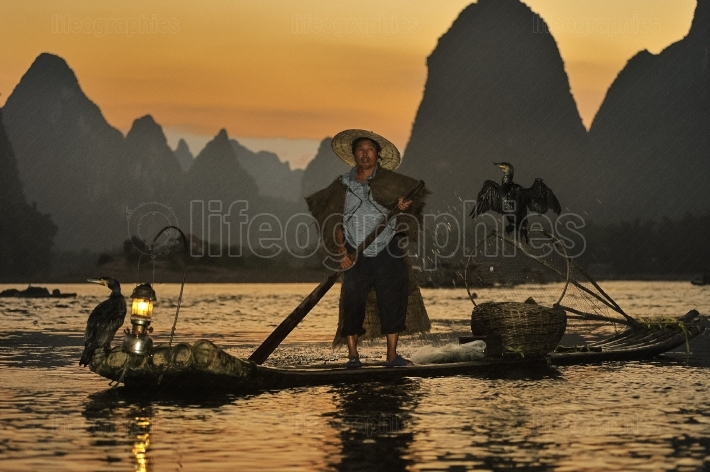 Cormorant fisherman from village of xing ping, china